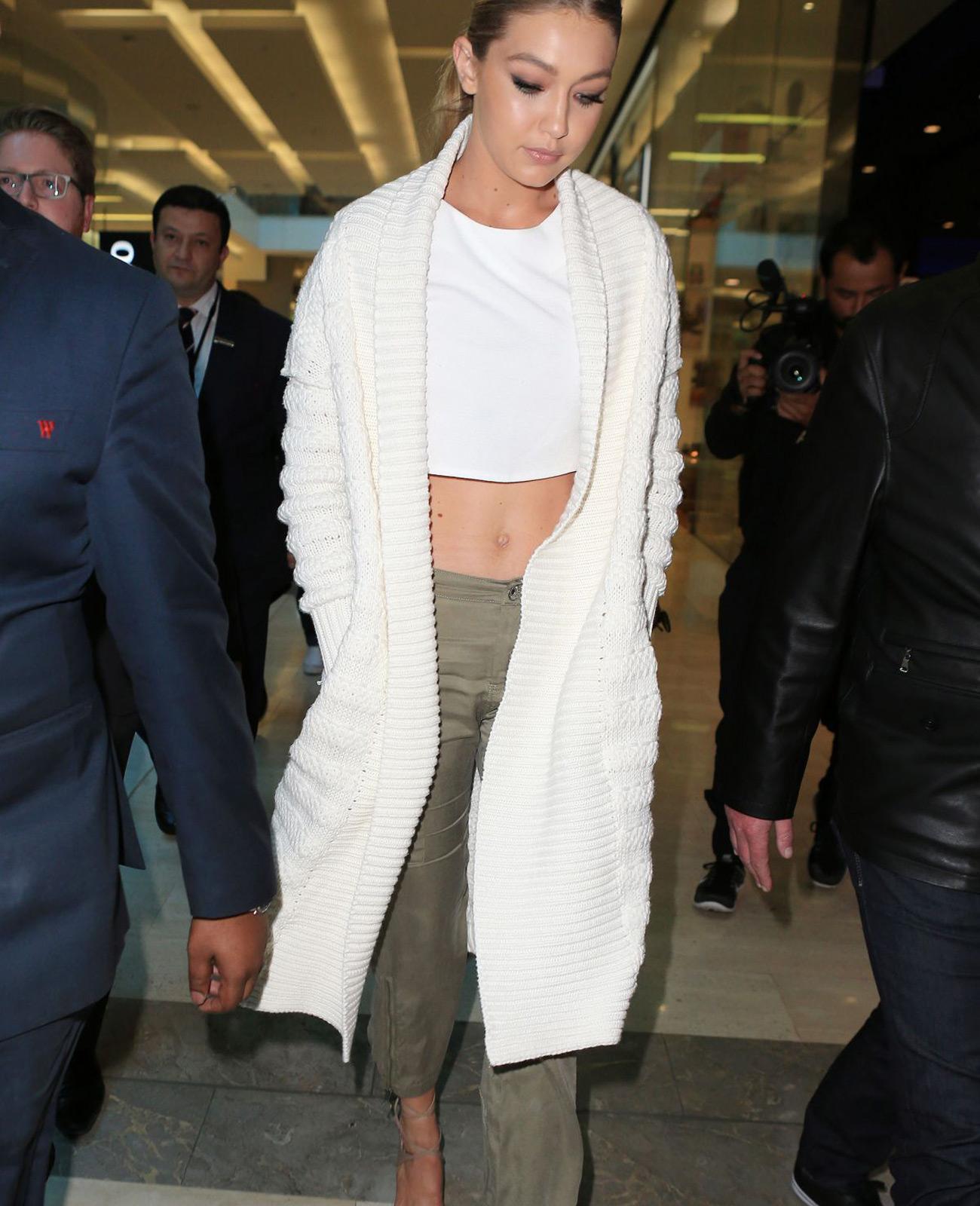 GiGi Hadid White Long Sweater Army Green Pants